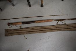 A vintage 12ft cane rod with spare tip in sleeve, unmarked