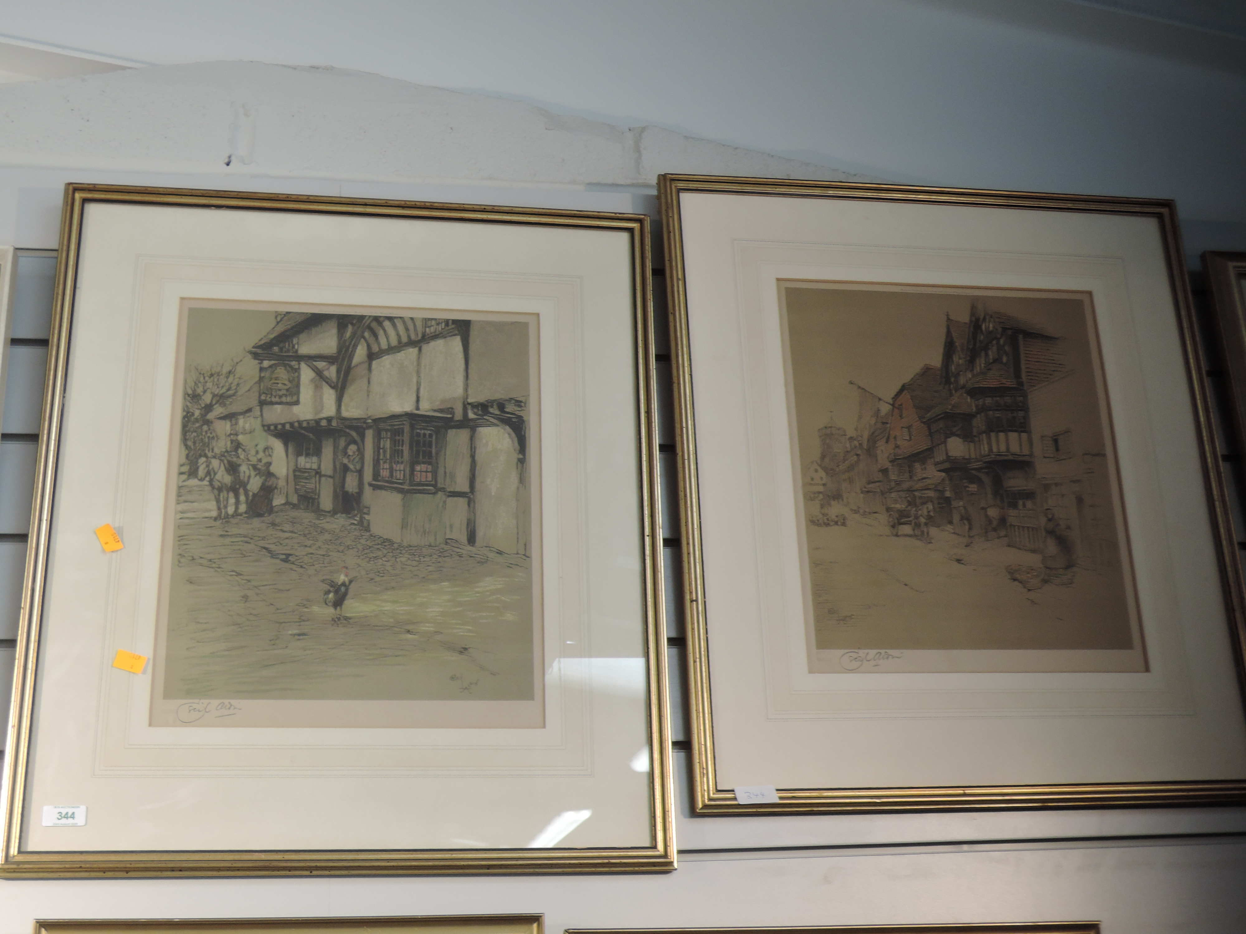 Lot 344 - Two prints, after Cecil Aldin, Old English Inns series, The Bell Inn, signed, framed and glazed 41 x