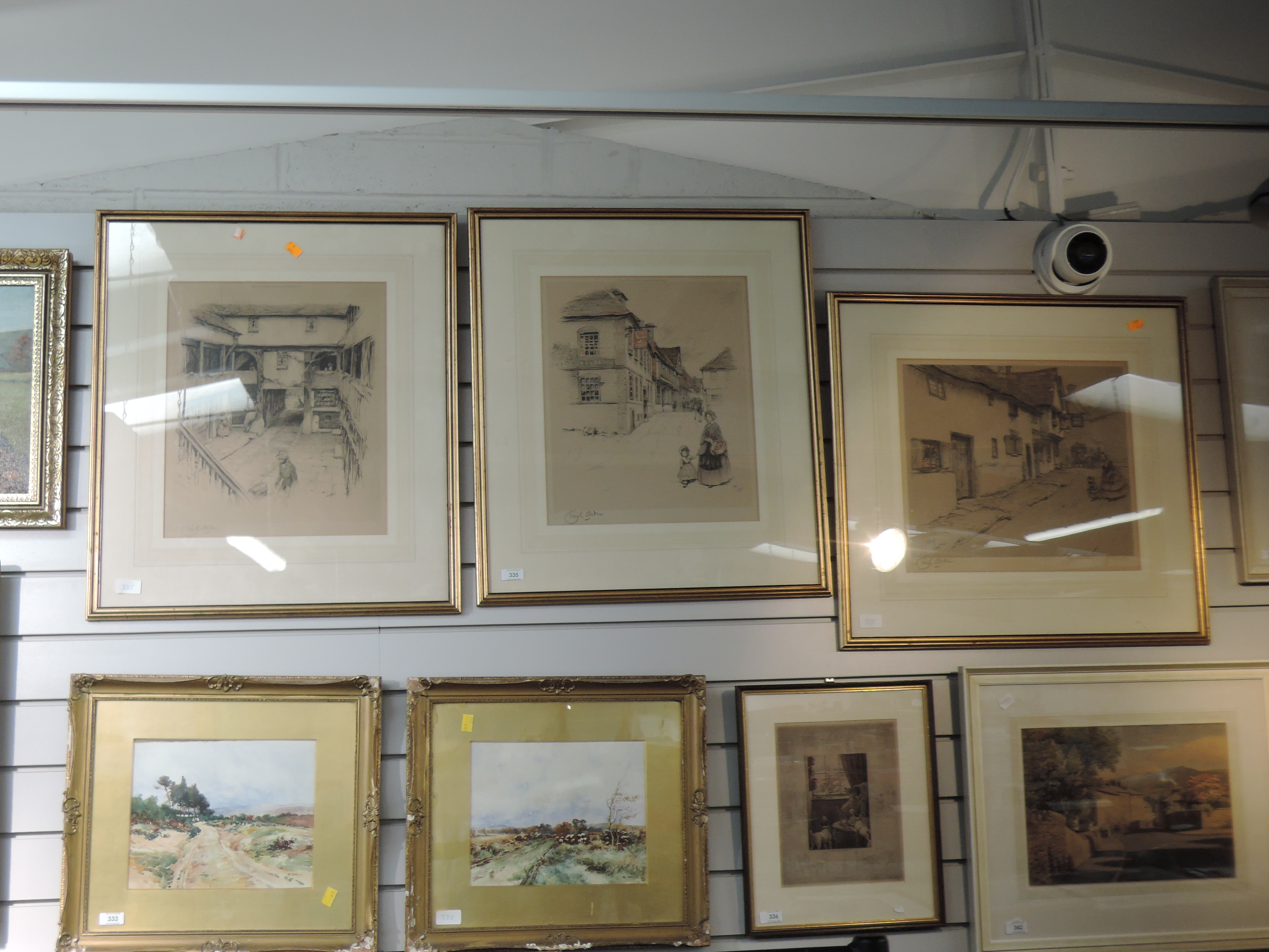 Lot 335 - Three prints, after Cecil Aldin, Old English Inns series, The Spread Eagle, Midhurst, signed, framed