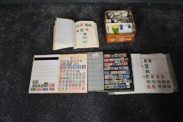 A collection of World Stamps in albums and loose, mint and used