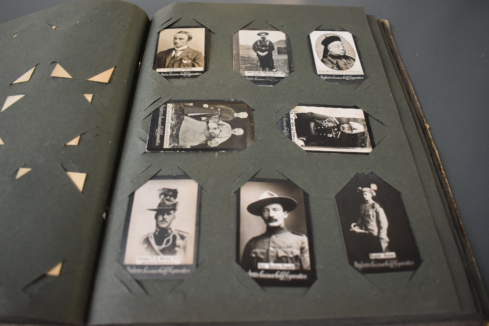 Lot 853 - An album of Ogdens Guinea Gold Cigarette Cards Real Photo's, mainly of Military interest,