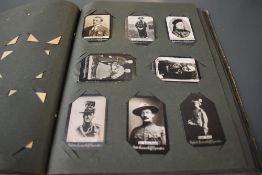 An album of Ogdens Guinea Gold Cigarette Cards Real Photo's, mainly of Military interest,