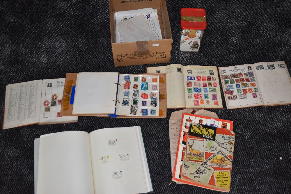 Lot 809 - A collection of mint & used GB and World Stamps in albums and loose