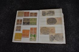 A 64 page stock book containing Fiscal and Cinderella World Stamps, Queen Victoria onwards including
