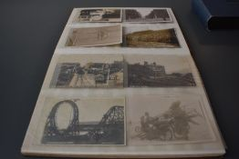 An Album of early Postcards including Military, Real Photos, Street Scenes etc, approx 60 cards