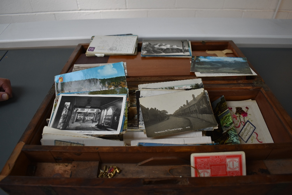 Lot 861 - A wooden Writing Slope containing early Postcards, varied subjects, Real Photo's ,Military, two