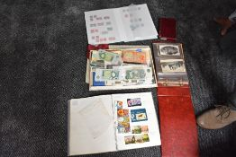 A collection of World Stamps, Covers, Postcards and GB Banknotes