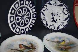 A collection of plates including two Royal Albert display plates having woodland bird scenes.
