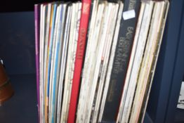 A selection of LP records including classical and swing.