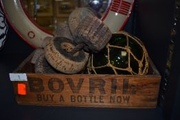 A vintage wooden Bovril box,a glass float and an assortment of cork fishing net floats.