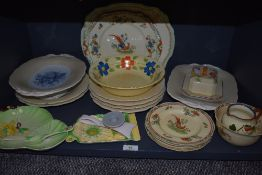 An assortment of ceramics including Carlton ware, Tudor ware and more, plates , bowls and butter