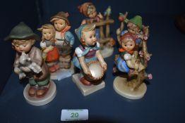 Six Goebel figurines including Apple tree girl.