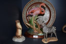 A selection of figurine,including zebra,flamingo and Aynsley otter also a micro mosaic charger.AF