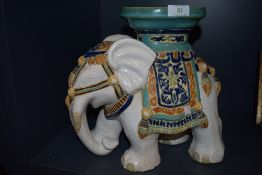 A plant stand in the form of an elephant.