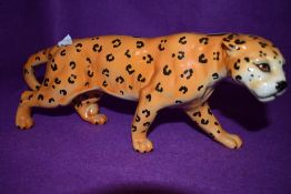 A ceramic figure of an African cat possibly Cheetah by Beswick