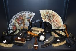 An assortment of dressing table mirrors, fans, glove stretchers,hallmarked brush, candle stick