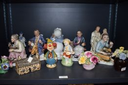 An assorted lot of figurines and ornaments among which are Crown Staffordshire and similar floral