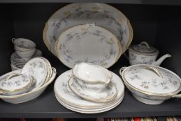 A Noritake 'waverly' part tea/dinner service including plates, tureens, tea pot and more, around