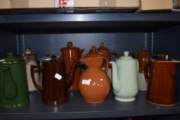 A mixture of coffee pots including Woods ware, Sadler and Denby.
