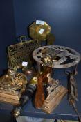 A collection of vintage brass including trivet, letter rack, novelty fly match striker and more.