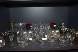A mixture of vintage glass including etched fruit glasses or similar, amber coloured glass stemmed