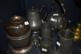 A selection of plated wares and pewter among which are a decorative teapot with embossed design