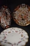 Three Royal Crown Derby plates, two having Imari pallet and the other having fluted edges,delicate