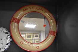 A vintage metal framed Lifebouy soap advertising mirror.