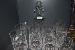 A set of whiskey tumblers and decanter also similar Waterford tumblers.