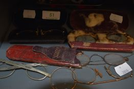 A selection early yellow metal rimmed spectacles.