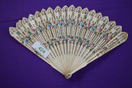 An ivory Brise fan, around 1815, with painted roses and forget-me-nots to front and similar to