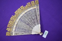 An ivory Brise fan circa 18th century with very fine pierced blades,with carved tips and gilt
