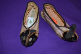 A pair of vintage children's slippers or shoes having oriental styling and rabbit faces to toes in