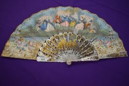 A hand painted lithograph fan, circa 1850, showing classical scene with ornate inlaid mother of