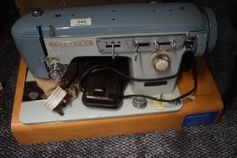 A vintage brother sewing machine and case serial number M768432.