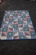 A retro patchwork quilt with fleece edges and sheepskin lining,made in germany,single in size.