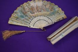 A hand coloured French fan, circa 1840, with lithographic classical scene to front and country