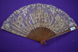 A lace fan having sequins and spangles with early plastic ribs, around early 20th century.