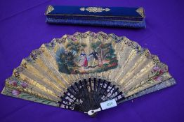 An early 19th century fan, thought to be for the Chinese export market having hand painted scenes to