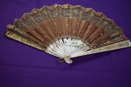 A late 19th early 20th century silk fan having sequins and spangles with mother of pearl ribs with