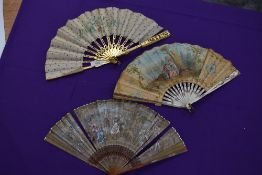A lot of three 19th century fans, painted silk leaf fan with gilded wooden ribs,another in silk with