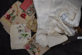 A collection of vintage and antique table linen with embroidered pieces, crotchet work and some