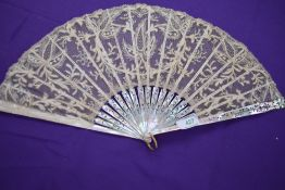 A lace fan, around 1870/80 with mother of pearl ribs with gilt floral detailing.
