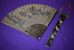 A hand painted paper fan, around early 18th century,depicting Chinese scene with mother of pearl