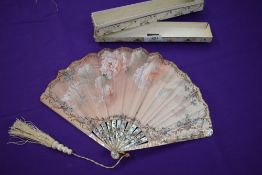 A 19th century Fan in box,having mother of pearl ribs with gilt detailing and silk painted leaf with