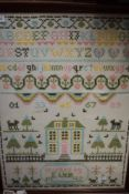 A framed cross stitch sampler worked by E Wier 1992, depicting animals,house,alphabet and more.