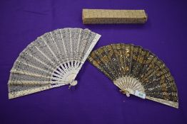 Two late 19th/early 20th century fans, both having sequins and spangles on gauze like fabrics.