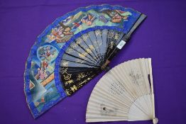Two fans, one Chinese,around 18th century with paper leaf and ivory ribs depicting lady, the other a