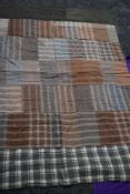 Three vintage quilts, two patchwork with wools and similar, the other having a border with a coral