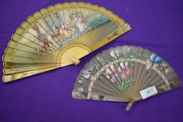 Two fans, one around 19th century depicting a classical scene,the other early 20th century having